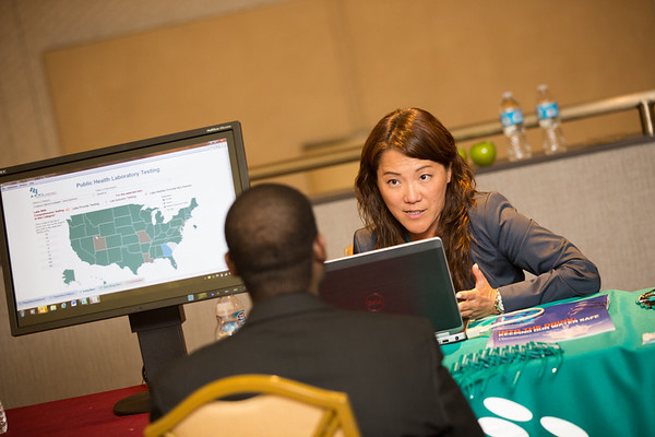 APHL's director of institutional research, Deborah Kim, shares the Data Visualization Dashboard with a meeting attendee | www/aphlblog.org