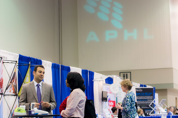 Attendees visit the exhibit hall